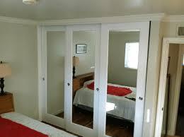 image of mirrored bifold closet doors bedroom