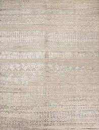 the shimmer of bamboo silk contrasts wool in a pale colorway of the anthar rug a reproduction of a carpet originally woven by three artisans who disagreed
