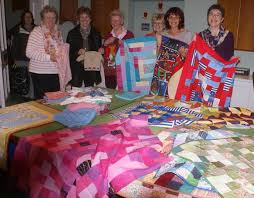 Project Linus UK benefits from Wilmslow Golf Club's ladies ... & Wilmslow Golf Club lady captain Elizabeth Black and fellow willing golfers  with a selection of quilts Adamdwight.com