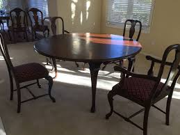 elegant round drop leaf wooden dining table with four chairs total two