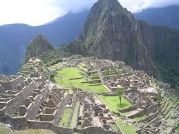 the new seven wonders of the world machu picchu from a distance the ruins mountain wina picchu behind it the new seven wonders of the world