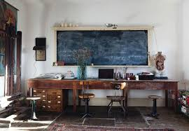 awesome rustic home office desks which is implemented below big black colored chalk boat and next to wooden windows framed in the room side beautiful unique office desks home office