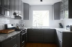 ikea shaker kitchen cabinets fancy black steel ceiling lamp simple wooden floor parquet flooring fancy curved white ceiling light simple white granite