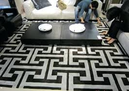 great does anyone know who s this u white geometric rug black and uk