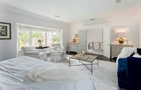 bedroom staging. This Spacious Master Bedroom Is In White And Utilizes Lamps Mirrors To Help Reflect Light Staging