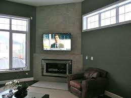 living room fireplace tv the challenge for the living room fireplace tv was to mount the tv low enough for viewing while still covering the recessed cable
