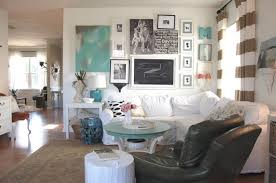 Read more about our paint colors our white walls, our sofa, and the gallery  wall