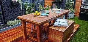 diy outdoor living area. outdoor table with drink coolers diy living area