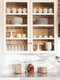 Delightful Kitchen Vignette Featuring Custome Glass Front Cabinets With  Gold Phillip Jeffries Moroccan Wallpaper Lined Cabinets Against Carrara  Marble Slab ...