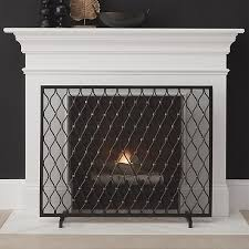 our beautiful fireplace screen patterns the hearth with a sophisticated trellis motif handcrafted in india