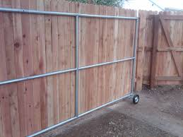 Wood Fence Ideas With A Gate Steel Framed Roll Gate With Wood