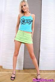 Blonde teen pussy in skirt