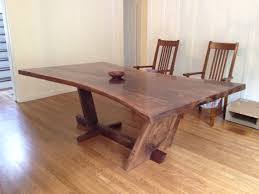 Japanese Style Dining Table Hourglass Shaped Walnut Slab Dining Table With A Live Edge And A
