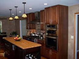 kitchen design cabinets traditional light: brown kitchen cabinets with under cabinet microwave and