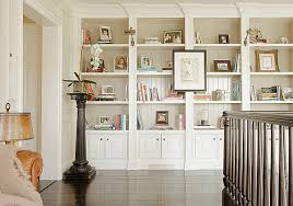 View in gallery Artwork and photographs on bookshelves