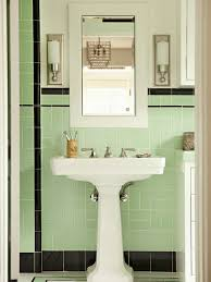 Traditional bathroom by Tim Barber LTD Architecture & Interior Design.  Black, white and light mint-green tiles are a nostalgic choice full of  charm.