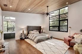 spacious master bedroom suite addition for 78704 stucco modern home new separate warm wood entry allows owners to come and go from their main level