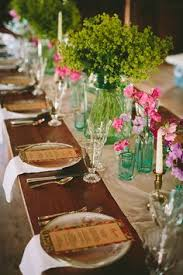 consider a runner under the table settings instead of down the middle of the table for
