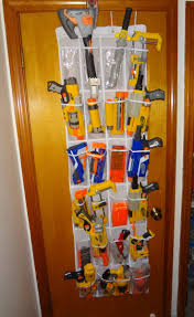 Hang a wire rack on your wall using screws, anchors, or other attachments depending on the wall material. Storage Ideas Nerf Gun Storage Ideas