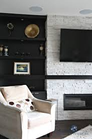 contemporary modern fireplace with dark wood built ins and floating shelves with travertine ledgestone kylie m interiors decorating and design e decor