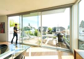 man opens large sliding patio door between balcony and dining area how much do glass doors