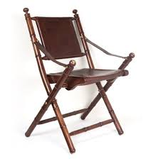 a folding officers chair teak leather and copper
