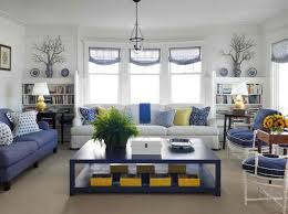 use blue pieces on white walls for a clever way to open up a living room space