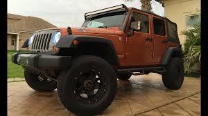 jeep wrangler mango tango color with a 3 5 aev lift kit oracle halo lights