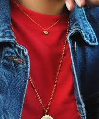 perfect for layering this 18 carat yellow gold vermeil pendant on adjule chain necklace features a turquoise gemstone pupil and contrasting white