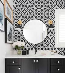 Bathroom With Framed Wall Decor And Round Mirror Also Gold Black ...