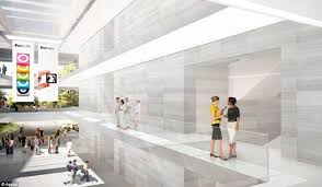 apples office. much of the inside futuristic building will also be made glass with stone apples office