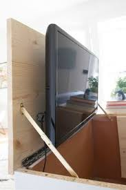hidden television furniture. whisper ride flat panel tv lift he has an electronic rack and pinion system that keeps tvs from 37u0027u0027 tou2026 hidden television furniture