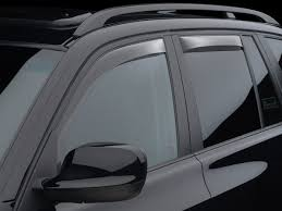 front and rear side window deflectors