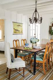 lighting over dining room table. Rustic Iron And Wood Dining. Surrounded By A Set Lighting Over Dining Room Table E