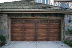 rustic garage doors dark wooden garage arched garage door stone siding grey roof rustic garage doors rustic garage doors