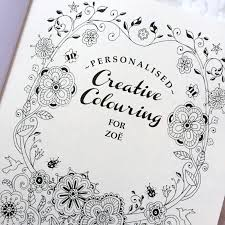i absolutely love my colouring book it has my name on the front and on the inside cover and as you can see from the photograph my umlauts are over my e