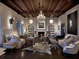 black and white zebra rug large living room with dark brown tile floor on which a black and white zebra rug