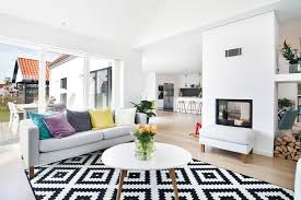 black white area rug colorful pillows grey sofa white coffee table glass sliding door with white