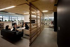 modern office lobby. office:comfortable office lobby interior design with cozy sofa seating and wooden railing wall divider modern t