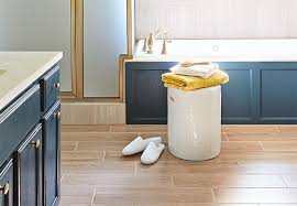 light tone planks of wood look tile flooring in a bathroom