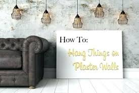 how to hang things on wall without holes wall hangers no holes how to hang things on plaster walls wall mounting without holes hang shelves without holes in