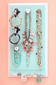 there are loads of jewelry organizing ideas out there cabinets to things to repurpose and lots of plans for diy jewelry organizers like this