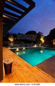 inground pools at night. Inground Pool At Night All Lite Up, Heated And Ready To Swim - Stock Image Pools