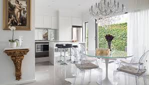 Glamorous and elegant, this kitchen and dining area is highlighted by the Ghost  chairs,