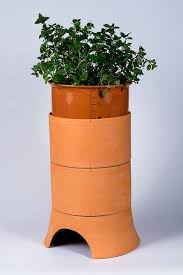 compost with style and with worms using this terracotta vermicomposter