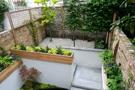 Small Picture Gravel small town garden with beautiful water feature planters