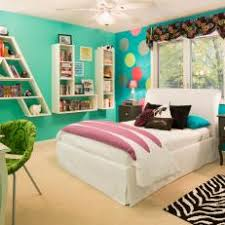 Bright Turquoise Tween's Bedroom Features Polka Dot Accent Wall