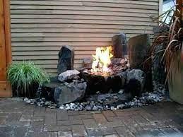 Water Fountain Fire Pit Combo Poible Water Fountain Song Meaning Garden Yard Ideas Water Fountain Garden Inspiration