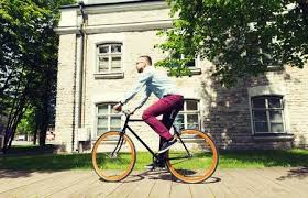 Happy Young <b>Hipster</b> Man Riding <b>Fixed Gear</b> Bike On City Street ...