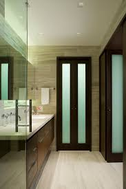 attractive bathroom closet door pivot contemporary with dark walnut double sink image by d p a c e studio ltd